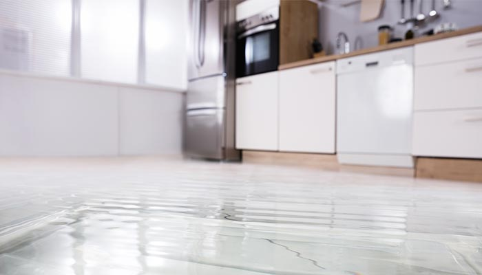 Flooded floor in a kitchen from North Queensland Insurance Brokers Townsville