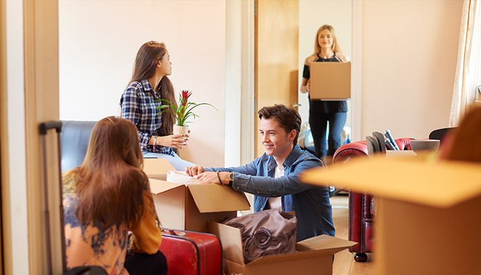 Renters unpacking boxes in their new residence in Townsville